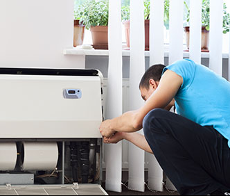 Man Installing Air Conditioner