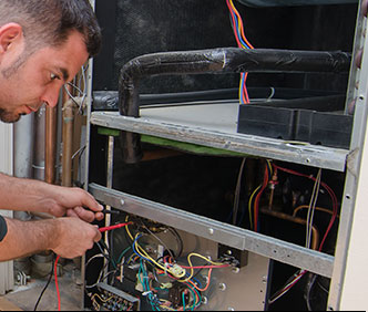 Man Repairing Air Conditioner | AC repair in Polk County, FL